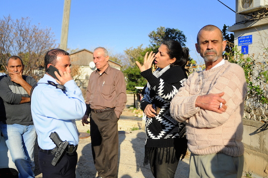 Ismail Shawa's daughter speaks with police officers outside the family home (Photo by Yudit Ilany)