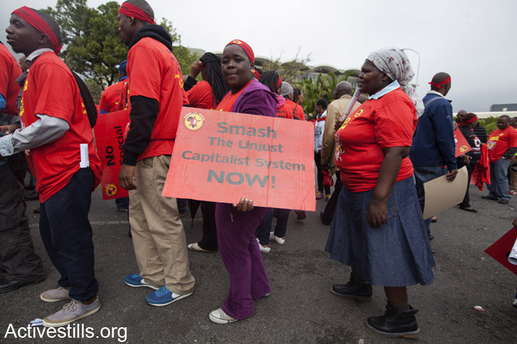 On March 19, 2014, NUMSA (National Union of Metal Workers of South Africa),  the largest labor union, led marches and a general strike all around South Africa. Around 2,500 NUMSA members and supporters from other movements and unions marched in the center of Cape Town. (photo: Activestills.org)