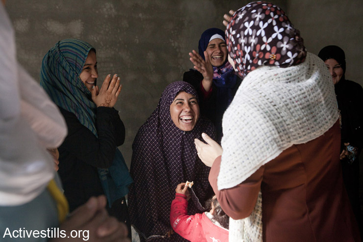 Women, many of whom were affected by the Israeli attack, after a psycho-social group session in a private home in Beit Lahiya. Gaza Strip, February 18, 2013.