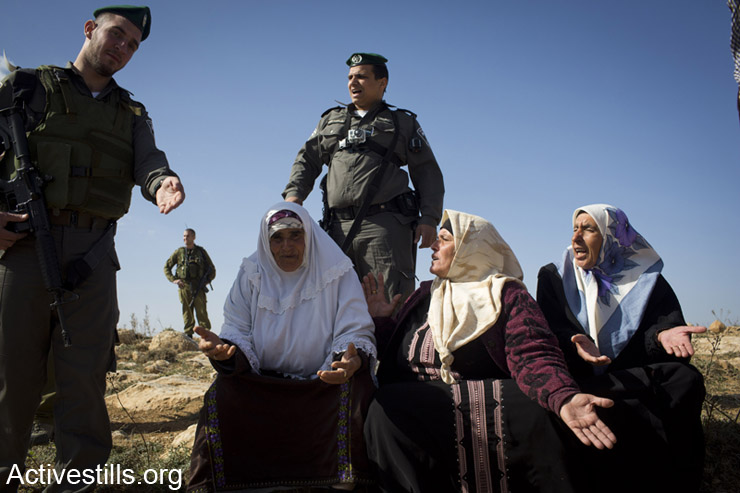 Palestinian women argue with Border Policemen who prevent them from reaching their pasture land, Umm-al-Arayes, South Hebron Hills, West Bank, January 26, 2013.