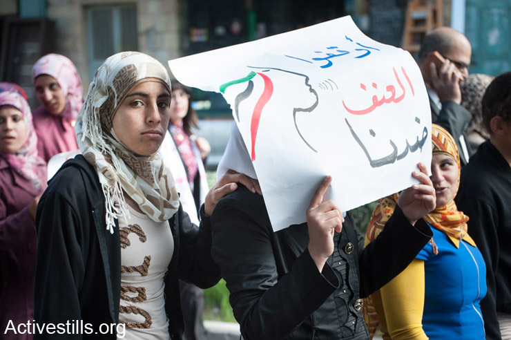 Women from the West Bank city of Bethlehem march to protest honor killings and other forms of violence against women, Bethlehem, November 16, 2013.