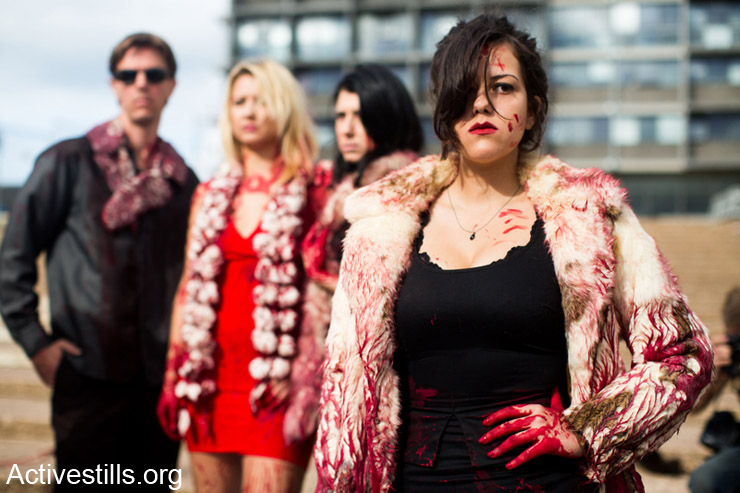 Anti-fur activists take part in a fake fashion show during the Worldwide Fur Free Friday (WFFF) initiated by the international Anti-Fur coalition to ask for the dissolution of the fur trade, Tel Aviv, November 28, 2013.