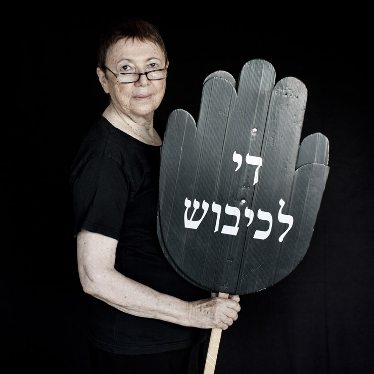 Yaffa Berlovitz Bloch, 76, active for 19 years in Women In Black, Tel Aviv group, holds a sign reading 'stop the occupation' in Hebrew.