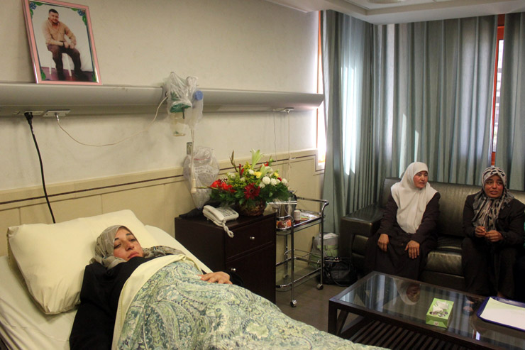 The wife of Abdel-Fatah shalabi, a Palestinian prisoner who's imprisoned in Israeli prison, lie in bed at a hospital in the West Bank city of Nablus before few hours of her Childbirth surgery, April 02, 2014. The wife delivered a baby conceived through artificial insemination after her husband's sperm was smuggled out from an Israeli prison. Shalabi was arrested in 2003 and sentenced to 20 years in Israeli prison. (Activestills.org)