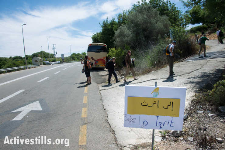 A handmade sign points the way to the displaced Palestinian village of Iqrit in northern Israel, April 21, 2014. Iqrit's original inhabitants were forcibly evacuated in the Nakba of 1948. Though the Israeli high court granted the residents, who are Palestinian citizens of Israel, the right to return to their homes in 1951, the military destroyed the village and has since prevented their return.