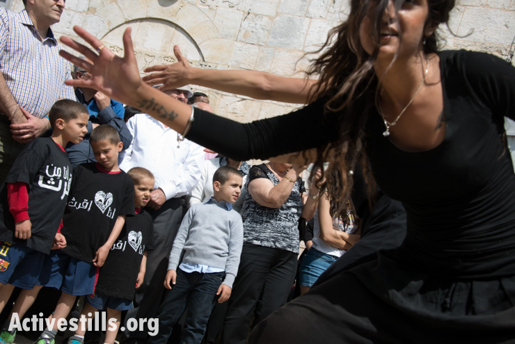 On Easter Monday in the displaced Palestinian village of Iqrit, youth perform an interpretive dance of the town's history. Northern Israel, April 21, 2014. Iqrit's original inhabitants were forcibly evacuated in the Nakba of 1948. Though the Israeli high court granted the residents, who are Palestinian citizens of Israel, the right to return to their homes in 1951, the military destroyed the village and has since prevented their return. Only the village's church and cemetery remained intact, and are still used by village residents while they campaign for a full return.