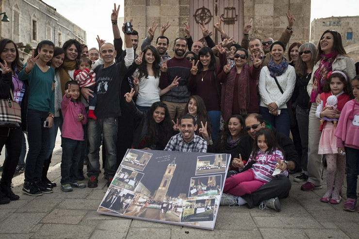 Former hunger striker, Samer Issawi, greeted by activists in Jaffa clock square, February 1, 2014. Samer Issawi was on hunger strike in the Israeli prison for more than 200 days, protesting his prolonged administrative detention. Jaffa activists staged daily protests in the months prior to his release, as part of the Samer Issawi campaign. (Activestills.org)