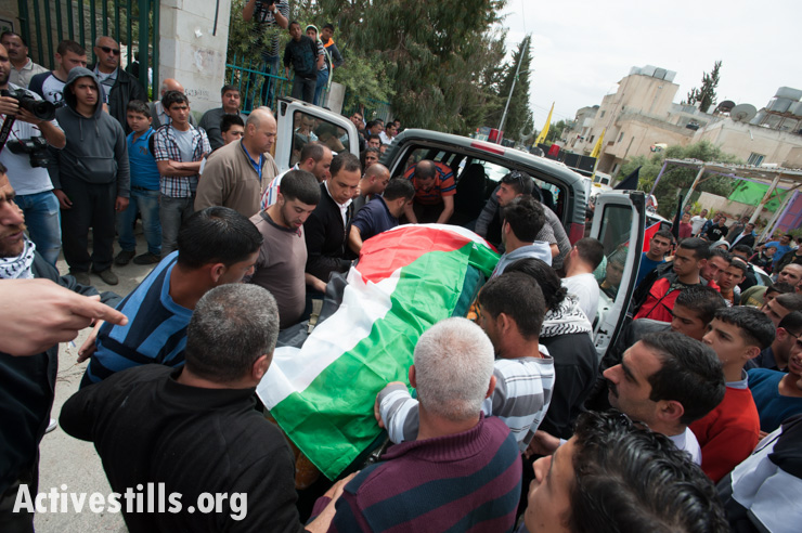 Mourners carry the body of Noha Katamish to the cemetery in Aida Refugee Camp, West Bank, April 15, 2014. Noha Katamish, who had asthma, died from the effects of a tear gas grenade fired into her home by Israeli forces the previous day. She was the mother of one daughter.
