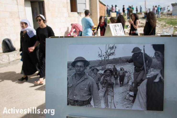 A historic photograph shows the displacement of the Palestinian village of Iqrit by the Israeli military in 1948. (photo: Activestills.org)