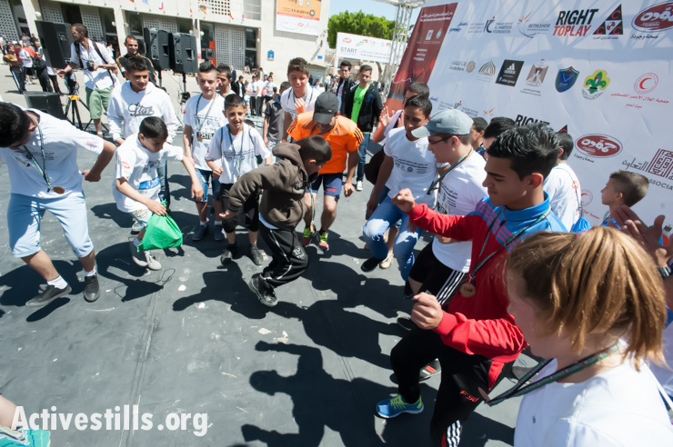 Participants of all ages dance in a post-race celebration after the second annual Palestine Marathon in the West Bank town of Bethlehem, April 11, 2014. (photo: Activestills.org)