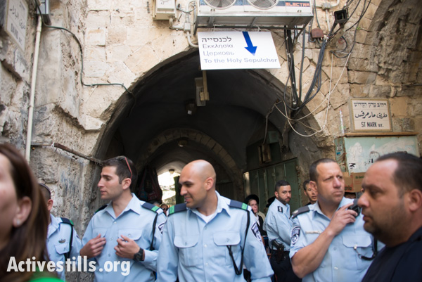 Israeli police block the way to the Church of the Holy Sepulcher, April 19, 2014. The Israeli High Court of Justice ruled this month that Palestinians' rights are being violated by checkpoints and other restrictions that annually create obstacles to worship. (photo: Ryan Rodrick Beiler/Activestills.org)