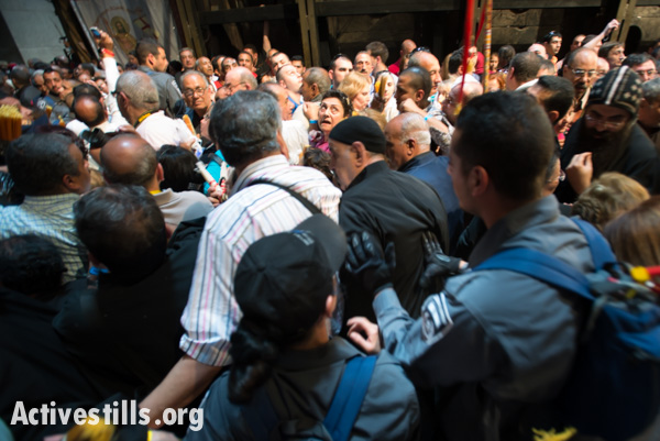 Israeli police push worshipers in the Church of the Holy Sepulcher in the Old City of Jerusalem, April 19, 2014. Many Palestinians report harsh treatment by Israeli police while attempting to access holy sites in Jerusalem. (photo: Ryan Rodrick Beiler/Activestills.org)