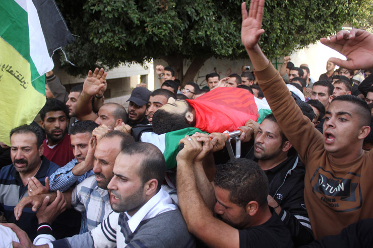 The funeral of Hasan Toraby, 22 years of age, who died at the Israeli hospital in Afoula after being denied essential medical treatment in prison, Sara, West Bank, November 5, 2013. Toraby was recently moved to the Afoula hospital after a sharp deterioration in his condition. He suffered from Leukemia, and was not provided the urgently needed specialized treatment. Toraby was from Sara village, near the northern West Bank city of Nablus. (Activestills.org)