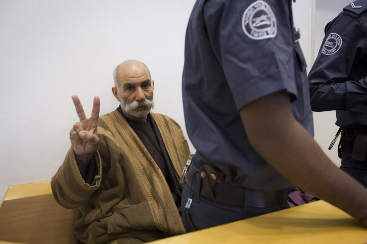 Sheikh Sayah Aturi seen inside the Be'er Sheva court for his hearing, November 28, 2013. Sayah was arrested on November 20, after his village Al Araqib was demolished by the Israeli authorities. Since then he remained in jail, after refusing to sign an order denying him entrance to his lands. The court decided to release him on condition of a week's house arrest in a location outside his village. (Activestills.org)