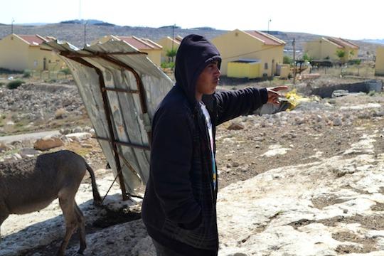 Palestinian village Umm al-Khir, and Israeli settlement Carmel, Area C, South Hebron Hills. 22 April 2014 (Photo: Dahlia Scheindlin)