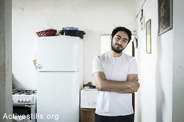 Majd Kayyal at his home in Haifa days after he was released from Shin Bet custody. (Photo by Shiraz Grinbaum/Activestills.org)
