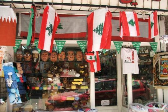 Flags and masks of Lebanese politicians at a Beirut shop, 2007 (Lisa Goldman)