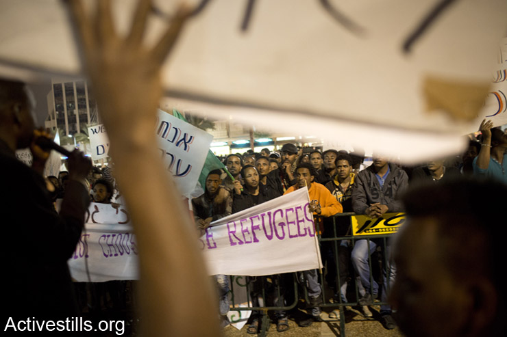 African refugees accompanied by Israeli supporters protest the Infiltration Law and imprisonment of asylum seekers in Holot Detention Center, Tel Aviv, March 29, 2014. (photo: Activestills.org)