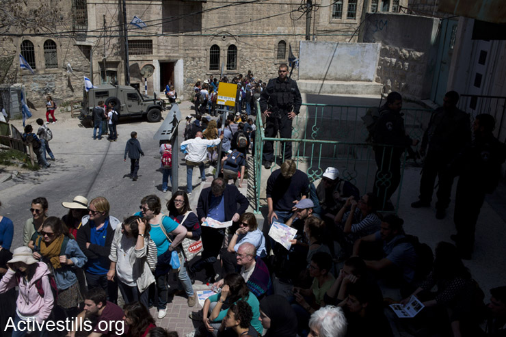 Participants of a tour of Hebron organized by 'Breaking the Silence' walk in the streets of the old city. Around 250 people participated in the tour. April 4, 2014. Breaking the Silence is an organization of Israeli army veterans who seek to expose the reality of their military's occupation of the Palestinian territories. (photo: Activestills.org)