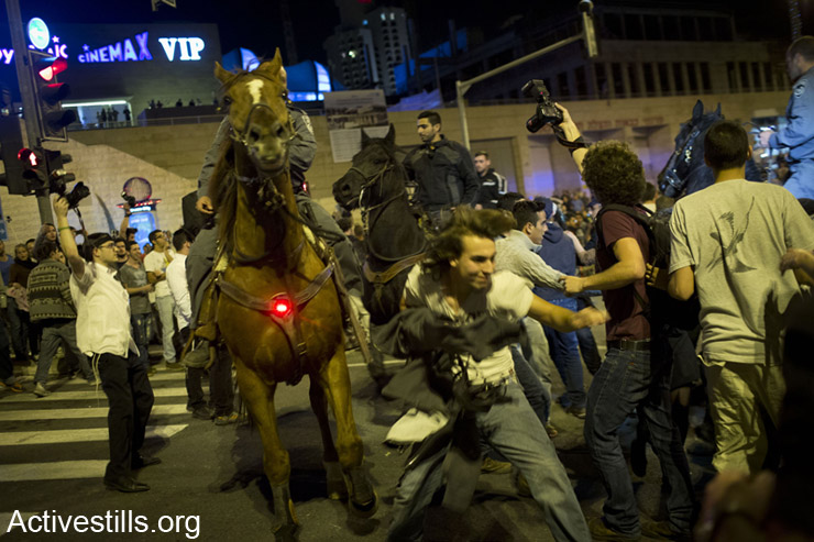 Mounted Israeli policemen disperse protesters, as over 1500 protesters block the road leading to the Israeli parliament, during an event calling on the Israeli government to legalize the use of Cannabis, in West Jerusalem, early morning of April 20, 2014. The protest event was entitled 'The Big Bong Night' and its organizers were arrested two days earlier, for openly calling the participants via social networks, to smoke cannabis during the protest. The Israeli police prevented the gathering in the park near the parliament and arrested over 30 protesters. (Activestills.org)