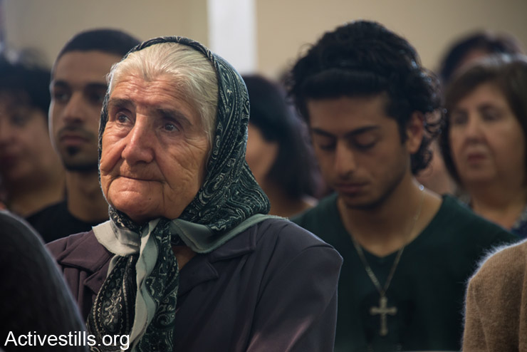 On Easter Monday, generations of the displaced Palestinian village of Iqrit celebrated mass in the town's church, the only building to remain standing. Northern Israel, April 21, 2014. Iqrit's original inhabitants were forcibly evacuated in the Nakba of 1948. Though the Israeli High Court granted the residents, who are Palestinian citizens of Israel, the right to return to their homes in 1951, the military destroyed the village and has since prevented their return. Only the village's church and cemetery remained intact, and are still used by village residents while they campaign for a full return. (Activestills.org)