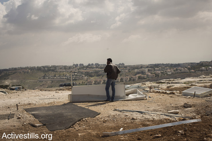 Back drooped by the Israeli settlement of Maale Adumim, a Palestinian man stands near a demolished house of his family, in the Jabal al Baba community in the E1 area near Jerusalem. Israeli anchorites demolished 3 houses built by the EU and issued 18 demolition orders to houses in the area.