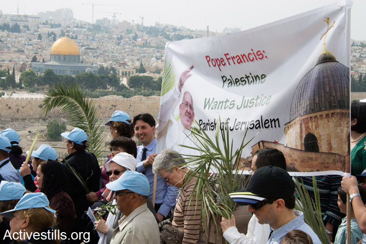 """Palestinian Christians from Jerusalem carry a banner reading, """"Pope Francis, Palestine Wants Justice,"""" in the annual Palm Sunday procession from the Mount of Olives to the Old City of Jerusalem, April 13, 2014. Palm Sunday is the Christian celebration of Jesus' triumphal entry into Jerusalem as the """"Prince of Peace"""" the week before his crucifixion. Though annexed by Israel in 1967, the international community considers East Jerusalem, including the Mount of Olives and the Old City, to be occupied Palestinian territory. Palestinian Christians from Jerusalem carry a banner reading, """"Pope Francis, Palestine Wants Justice,"""" in the annual Palm Sunday procession from the Mount of Olives to the Old City of Jerusalem, April 13, 2014. Palm Sunday is the Christian celebration of Jesus' triumphal entry into Jerusalem as the """"Prince of Peace"""" the week before his crucifixion. Though annexed by Israel in 1967, the international community considers East Jerusalem, including the Mount of Olives and the Old City, to be occupied Palestinian territory."""