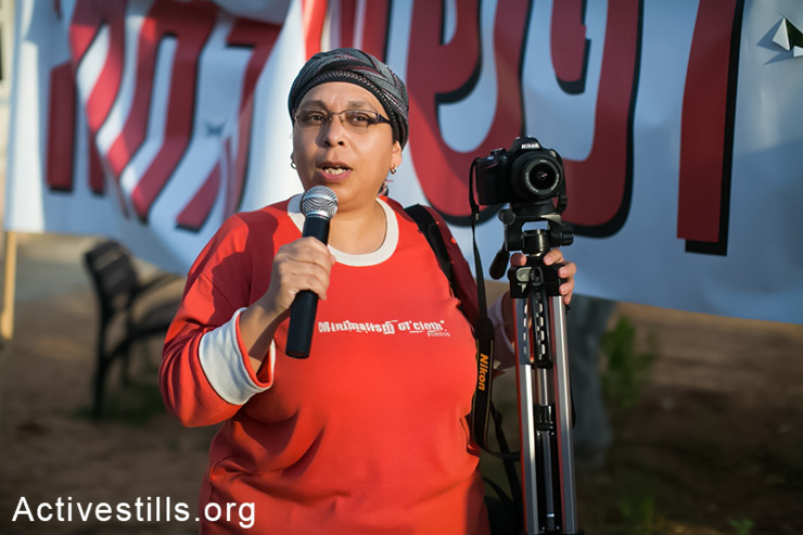 Uriel Ferera's mother talks during a protest in front of Hakiria military base in Tel Aviv in solidarity with her son, May 8, 2014. Uriel Ferera, 19, is anorthodox Jew from Beer Sheva who refuses to join the Israeli army and is currently imprisoned in a military jail. Uriel says he refuses to take part in the occupation and that his request for civil service instead of a military one was rejected by the army. (Activestills.org)