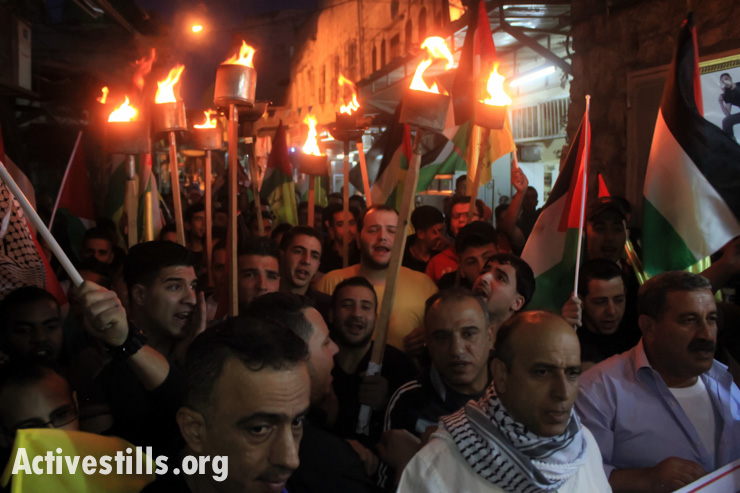 Palestinians demonstrate on the 66th anniversary of the Nakba in the West Bank city of Nablus, May 14, 2014.