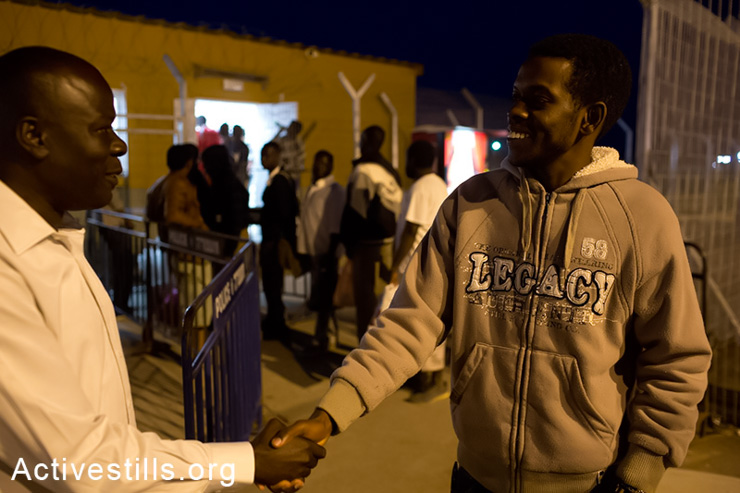 Sadik al Sadik, an Sudanese asylum seeker who was sent by the immigration authority to Ethiopia, is greeted by a friend after arriving at the Holot detention center in the Negev Desert, May 11, 2014. Sakid was arrested by the Israeli immigration authorities and agreed to leave for Ethiopia after he was told he would be sent to a third country in which he would get asylum. After landing in Ethiopia, he was told he had to fly to Sudan. He then refused and stayed at the airport for a whole week. A few days ago he was forced by the Ethiopian police to fly back to Israel. (Activestills.org)
