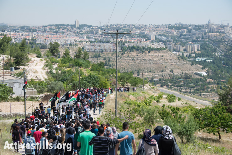 Palestinians march toward the Green Line in a Nakba Day protest in the West Bank village of Al Walaja, May 15, 2014.