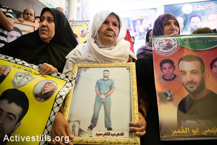Family members of Palestinian prisoners in Israeli detention hold a weekly demonstration at Red Cross headquarters in Gaza City, May 12, 2014. More than 100 Palestinian administrative detainees in Israeli prisons launched a mass, open-ended hunger strike on Thursday, April 24, 2014. The hunger strike comes after Israeli authorities reneged on an agreement after a previous hunger strike to limit the use of administrative detention to exceptional cases. (Activestills.org)