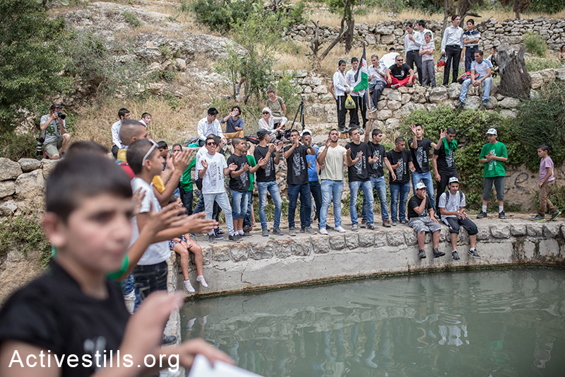 Palestinians celebrate during a festival by a natural spring at Lifta, on May 16, 2014 in Jerusalem. Palestinians came to mark the Nakba day. Lifta was a Palestinian village that was destroyed after the establishment of Israel. (Activestills.org)