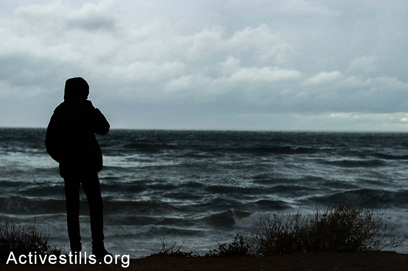 A man is faces the wind of a cold and stormy day on the Gaza coast. (Basel Yazouri/Activestills.org)