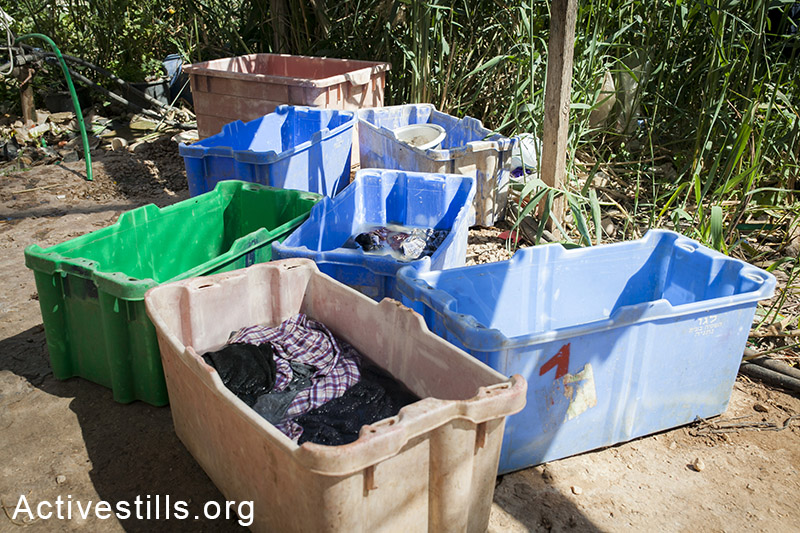 Laundry done outside in buckets. (Activestills.org)