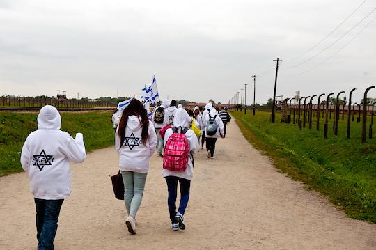 Israeli high school students visit the Birkenau concentration camp in Poland. (Photo by Borzywoj / Shutterstock.com)