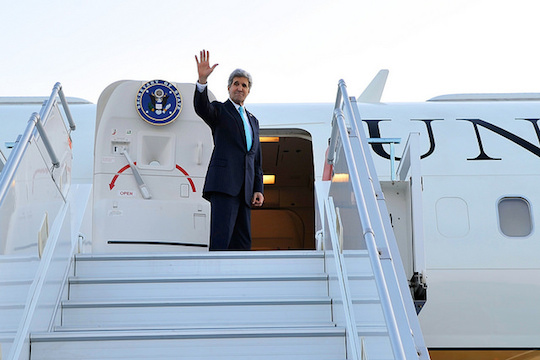 Secretary of State John Kerry waves goodbye. (File photo by State Dept.)