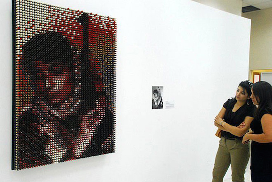 Leila Khaled portrait made of 3,500 lipsticks by Amer Shomali, February 28, 2012. (Photo by Amer Shomali) After Khaled hijacked two airplanes while still in her twenties, her image appeared on the covers of news magazines, her face was plastered on the walls of student dorms; she become a pop phenomenon, and an inspiration for TV and film characters.
