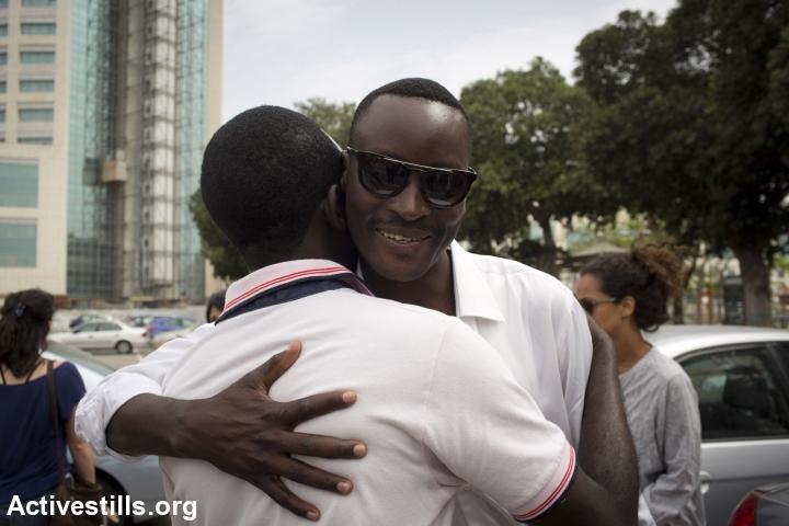 Mutasim Ali says goodbye to friends before being driven to Holot. (photo: Oren Ziv/Activestills.org)