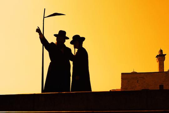 Illustrative photo of ultra-Orthodox Jews and a mosque's minaret. (Photo: Shutterstock.com)