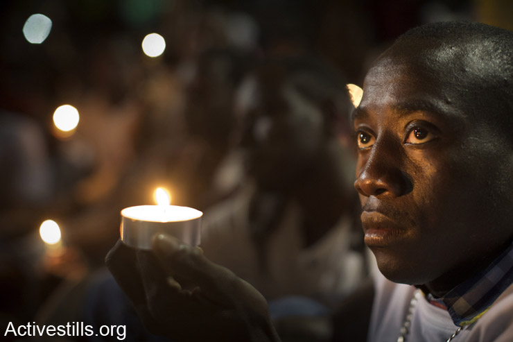 Asylum seekers from Darfur take part in the 11th memorial day for the genocide in Darfur, in Levinsky park, South  Tel Aviv, April 30, 2014.