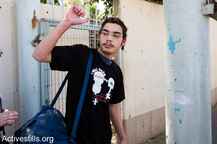 Uriel Ferera, 19-year-old orthodox Jew from Beer Sheva, enters Tel Ha'Shomer Military Base, where he will announce his refusal to obey the Israeli military draft, April 27, 2014. Ferera says he refuses to take part in the occupation and that his request for civil service instead of military duty was rejected by the army. (Activestills.org)