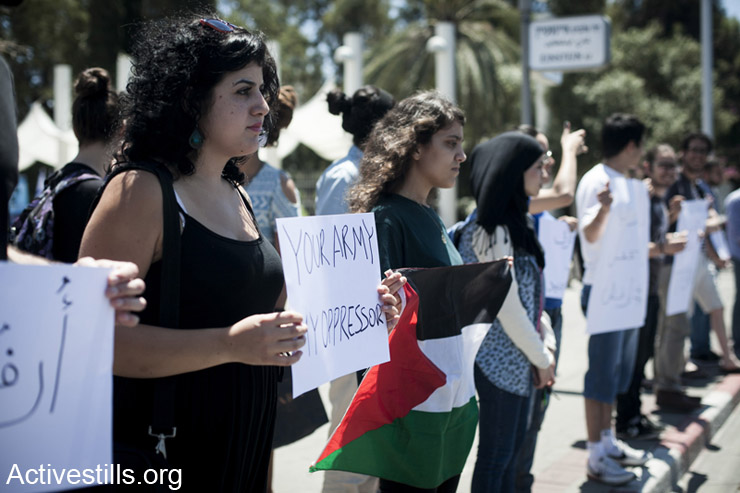 Students from Tel Aviv University protest a government plan to promote enlistment of Palestinian Christian citizens of Israel for military service, Tel Aviv, April 30, 2014. (Activestills.org)