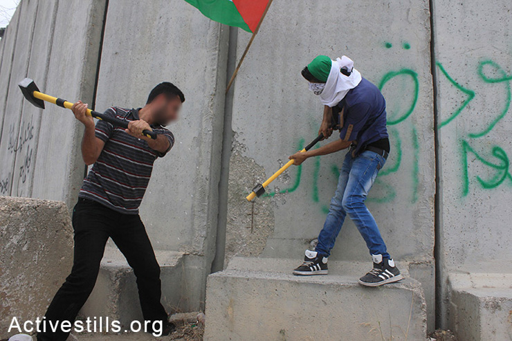 "Palestinian activists try to destroy parts of the separation wall during the 'Return March"" near Tulkarm, West Bank, May 31, 2014. Palestinians tried to cross the barrier while chanting for their destroyed villages and towns located inside Israel. By 1948, Zionist gangs ahd destroyed more than 500 Palestinian villages prior to the establishment of the State of Israel."
