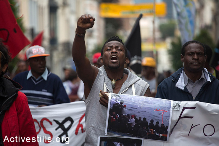 An activist shouts slogans during the final day of the March for Freedom of migrants, Brussels, Belgium, June 20, 2014. (Activestills.org)