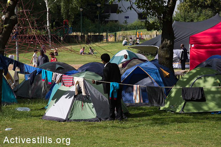 Tents in the protest camp established by hundreds of migrants and asylum-seekers in a park in Brussels, Belgium, June 25, 2014.  The camp was built after the arrival of the March of Freedom which crossed different countries during a 5-week, 500-kilometer journey. (Activestills.org)