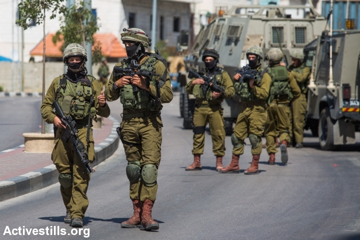 Israeli soldiers raid the West Bank city of Hebron on June 17, 2014, as the hunt for three Israeli teenagers believed kidnapped by militants entered its fifth day. Thousands of Israel troops engaged in the search for the youths. Overnight, the army turned its attention during the night to the northern West Bank city of Nablus and surrounding areas, arresting dozens of Palestinians. (Photo: Tess Scheflan/Activestills.org)