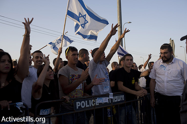 Right wing Israelis shout racist slogans during an anti-Palestinian demonstration at the Gush Etzion junction, a settlement next to the Palestinian town of Bethlehem ,on June 16, 2014. (Oren Ziv/Activestills.org)