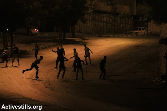 Clashes erupt after the Israeli army raided Balata Refugee Camp and several neighborhoods in Nablus, West Bank, June 27, 2014. (Photo by Ahmad Al-Bazz/Activestills.org)