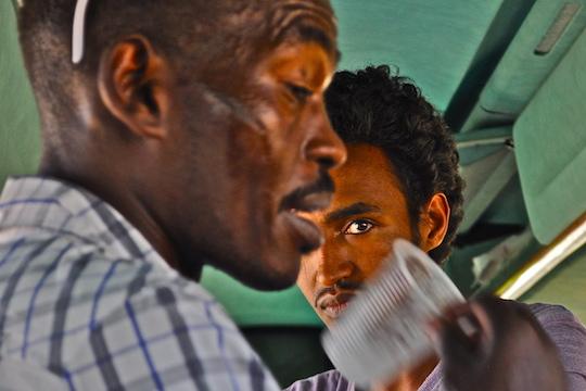 Asylum seekers on the bus to Holot and the Nitzana Forest, June 28, 2014. (Photo by Noam Shemtov/+972)